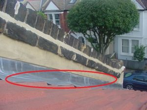 Poorly fitted lead flashing to parapet wall