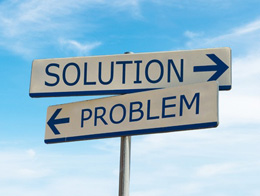 Sign with directions towards a solution and towards a problem
